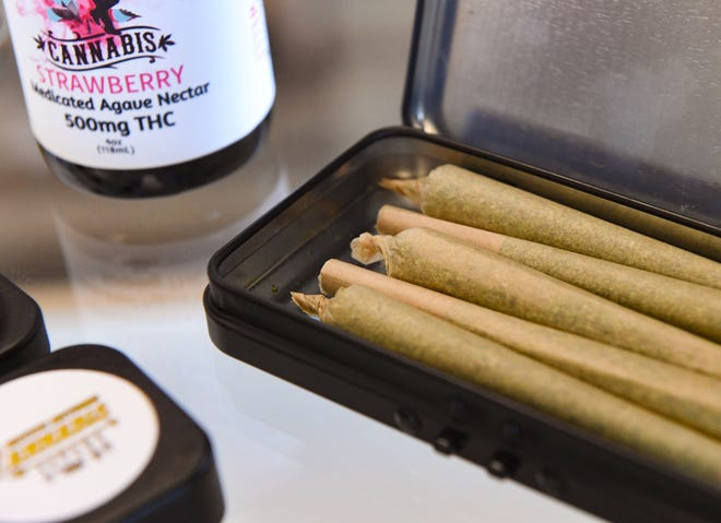 Joints sit in a case on Thursday, July 1, 2021, at Native Nations Cannabis in Flandreau.
