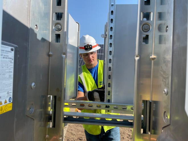 Grant Koerner works as an electrician at Muth Electric's solar power project at POET's headquarters in northern Sioux Falls. He secured a full-ride scholarship from tech school a few years ago. July 1, 2021.