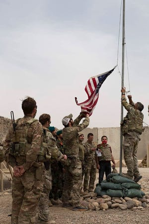 U.S. soldiers lowering the American flag during a handover ceremony in Helmand province to the Afghan National Army on May 2, 2021.