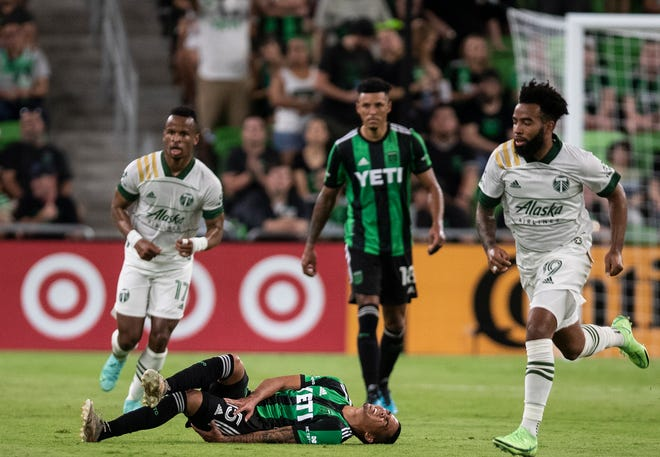 Austin FC midfielder Daniel Pereira goes down during the second half of the July 1 match against Portland. The rookie sensation has missed extended time this season with two separate injuries, and he's not alone. Alex Ring andCecilio Domínguez also have been out.
