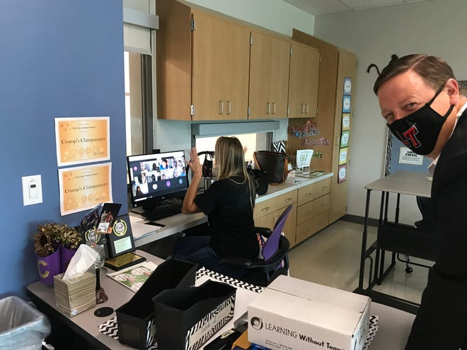 Lake Travis school district Superintendent Paul Norton peeks into a remote class in August. In math, the number of students in Lake Travis schools who did not meet grade level on the STAAR test rose from 8.9% in 2019 to 17.3% in 2021. Statewide the number went from 21% to 37%.