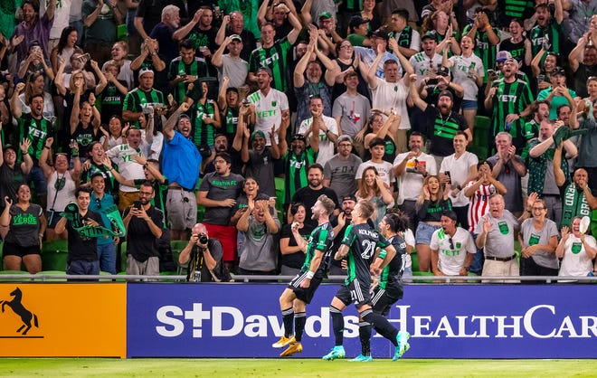 Austin FC forward Jon Gallagher celebrates with his teammates after scoring the first goal at Q2 Stadium against Portland on Thursday.