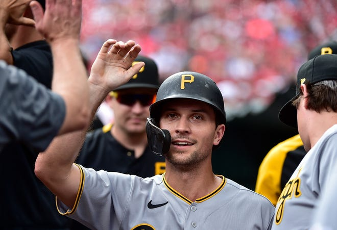 Pittsburgh Pirates second baseman Adam Frazier, a former Oconee County star, is congratulated by teammates after scoring during the first inning against the St. Louis Cardinals at Busch Stadium. Mandatory Credit: Jeff Curry-USA TODAY Sports