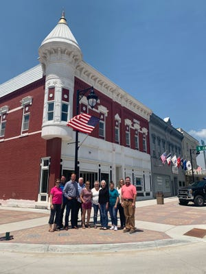 An iconic, historic building in downtown Nevada received a $100,000 grant from the Iowa Economic Development Authority. Pictured from left: Lisa Oxley, vice president of Main Street Nevada; Steve Skaggs, president of Main Street Nevada; Jon Augustus, building owner; Al Kockler, building owner; Linda Wendt, Evie Peterson, Ros Dunblaizer, Paula Feltner, Christa Skaggs; and Henry Corbin, executive director of Main Street Nevada.