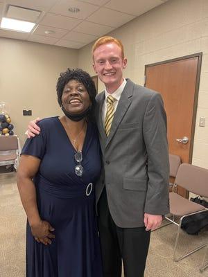 Retired Hampton County Auditor Teresa Williams, at left, with Deputy Coroner Preston Altman during her retirement drop-in.