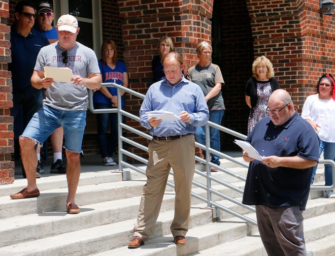 From left, attorney Jud Woodley, attorney Patrick Howard and District Judge Mike Smith hold their copies of the Declaration of Independence outside the Brown County Courthouse Friday as Smith takes a turn reading from the document.