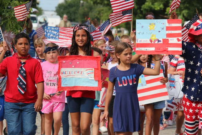 Children and staff members from the Little Dude Ranch child care center put on a colorful Independence Day parade on Stewart Street in Brownwood Friday morning. A patriotic parade in honor of Independence Day has been a tradition for the family-owned Little Dude Ranch, at  1601 Stewart, for 46 years.