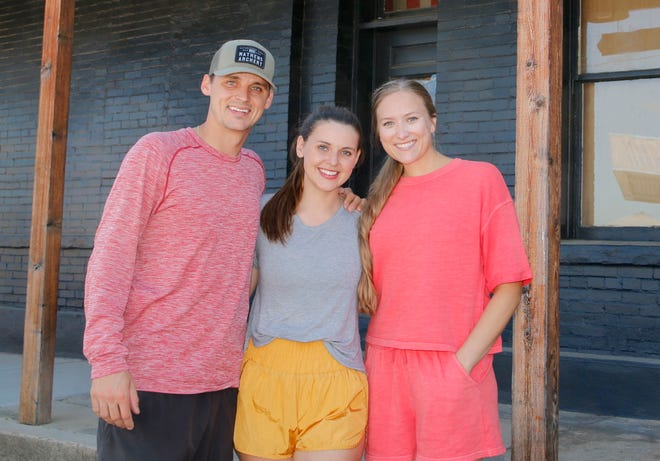 Lizzie McCrane (center) is flanked by her brother, Matt, and sister-in-law Megan McCrane.