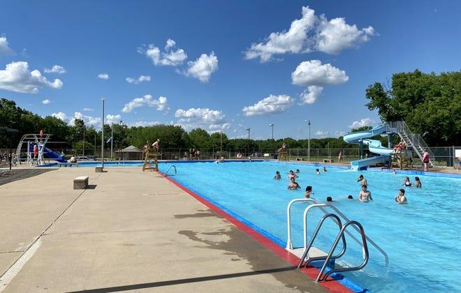 People enjoying the day at the El Dorado Municipal Pool