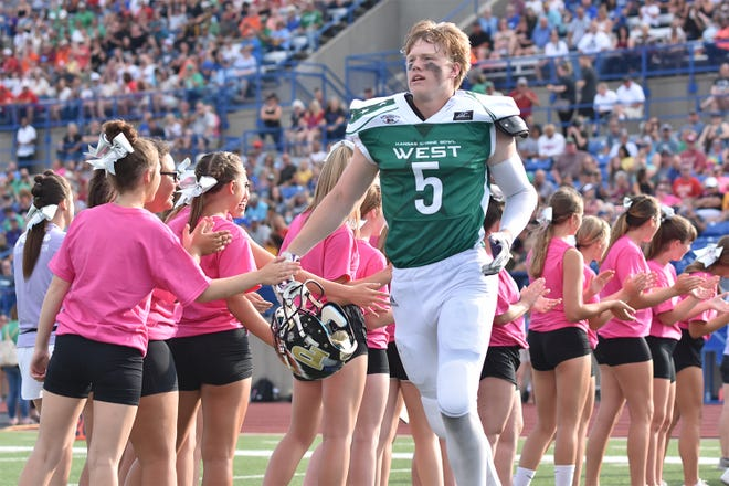 Ely Wilcox runs out onto the field for the starting lineups on Saturday, June 26 at Gowan Stadium in Hutchinson, Kansas for the 2021 Kansas Shrine Bowl.