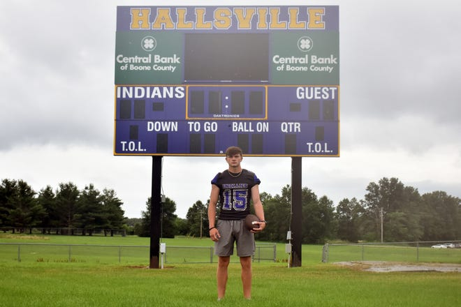 Hallsville graduate Ryan Roberts poses for a picture in front of the Indians' football scoreboard on Wednesday.