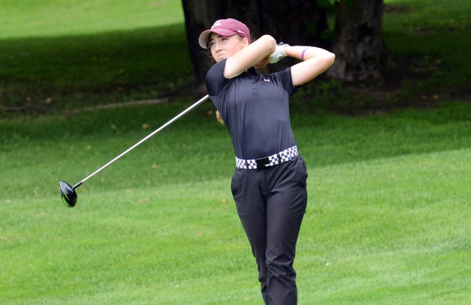 Kary Hollenbaugh of New Albany, Ohio follows her tee shot on No. 18 Thursday. The Ohio State commit earned her second AJGA win of the summer.