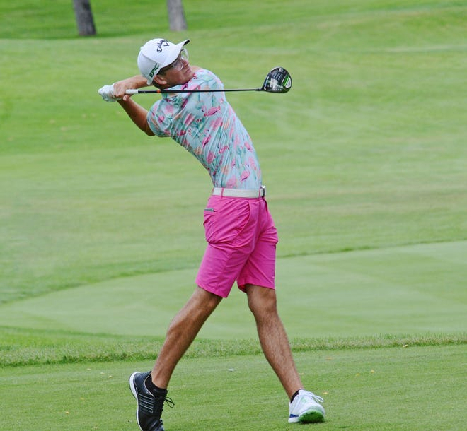 Cheboygan native PJ Maybank tees off during the final round of the Coca-Cola Junior Championships at Boyne Highlands in his bright colors and signature mismatched shoes. Maybank went on to win in a two-hole playoff.