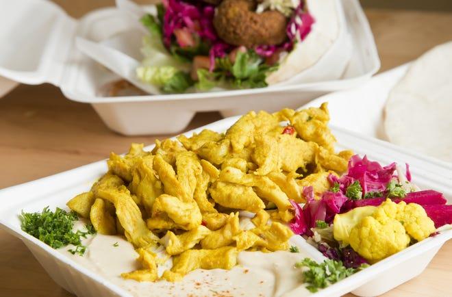 Chicken over hummus (foregound) with the falafel pita pocket at Falafel Kitchen.