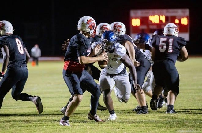 Lake Nona rising senior defensive lineman Zane Durant rushes the East Lake quarterback in 2020.