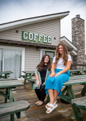 Whitney Scott, left, director of the Entrepreneurial Studies program at the Fort Osage School District's Career and Technology Center, and Emma Sears, a senior from Oak Grove, pose by the former Rockin' B Mercantile and Coffee Shop in Buckner. The Fort Osage Board of Education approved the purchase of the business to use for Scott's program, which will teach students how to run a real world business.