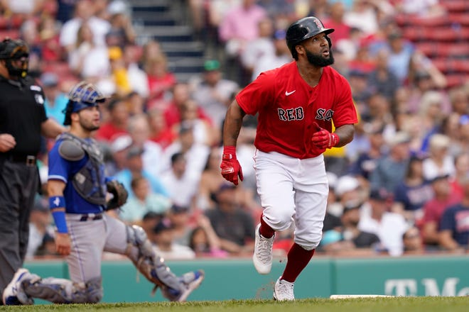 Boston Red Sox's Danny Santana watches his three-run homer in front of Kansas City Royals catcher Sebastian Rivero in the fourth inning of Thursday's game at Fenway Par in Boston. The Red Sox went on to drub the Royals 15-1.