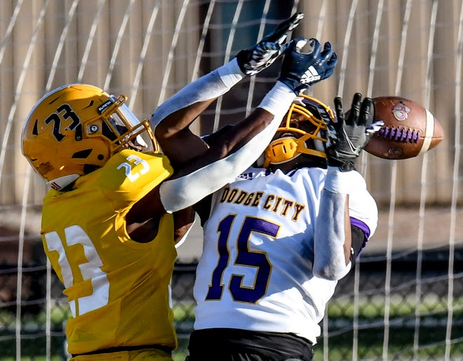 Garden City Community College defensvie back Antoine Davis, left, knocks the ball away from Dodge City wide receiver Tristan Jones in the endzone to prevent a touchdown May 1 at Broncbuster Stadium.  Davis is one of 45 GCCC student athletes recognized for their academic achievements by the Jayhawk Conference.
