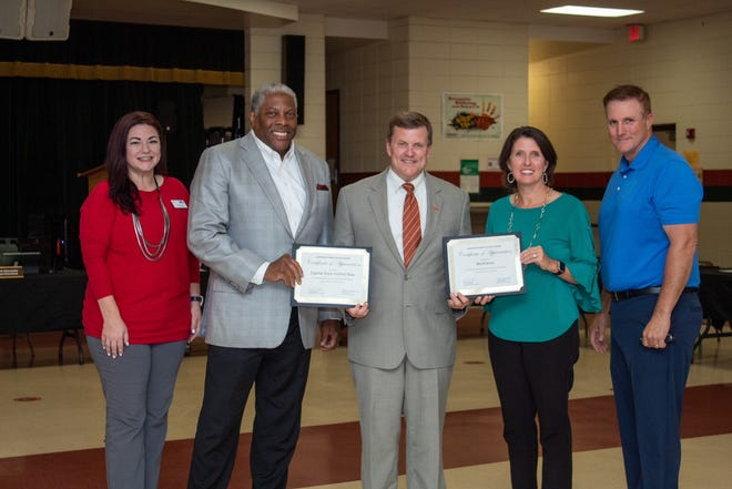 """Pictured from left: CAUW Director of Workplace Campaigns Ashley """"A.J."""" McDermott, CAUW President/CEO George Bell, Superintendent Alexander, Ascension Parish School Board Member and Methanex Director of IT Troy Gautreaux, Sr., and Methanex Manager of Stakeholder Relations Meg Mahoney"""