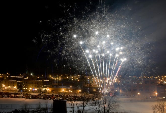 In this file photo, fireworks erupt over Water Street as part of Kelleher's Irish Pub & Eatery's New Year's celebration in Downtown Peoria.