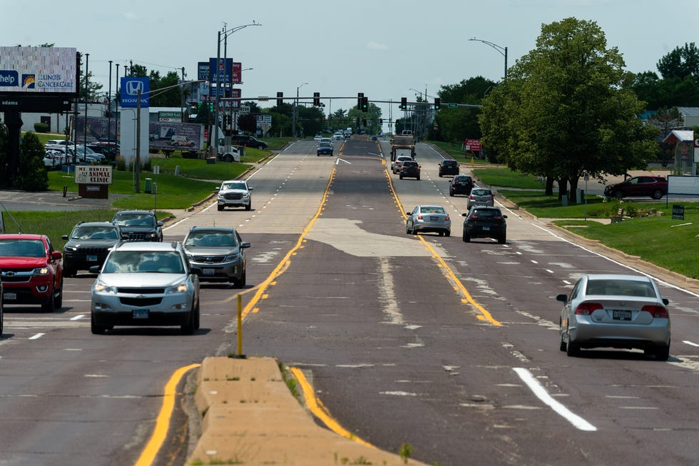Cars rumble down Pioneer Parkway on Thursday, July 2, 2021. The roadway falling into disrepair, but is set to receive federal and state funding for repairs.