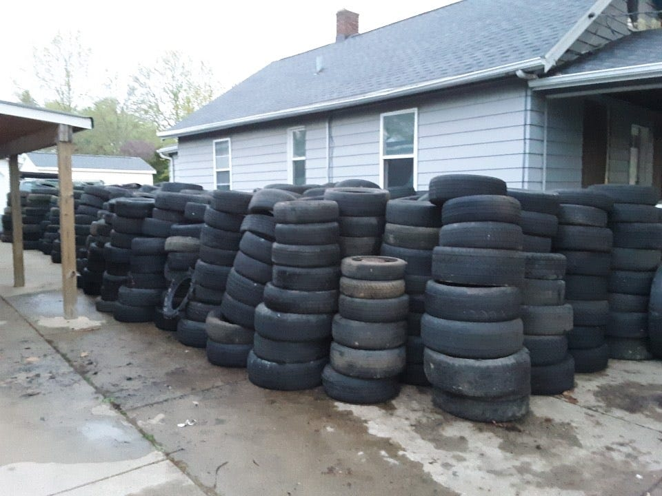 Used tires collected by south side Peoria's Arthur Ellington sit the driveway of his home. Ellington says there are 1,150 in this photo.