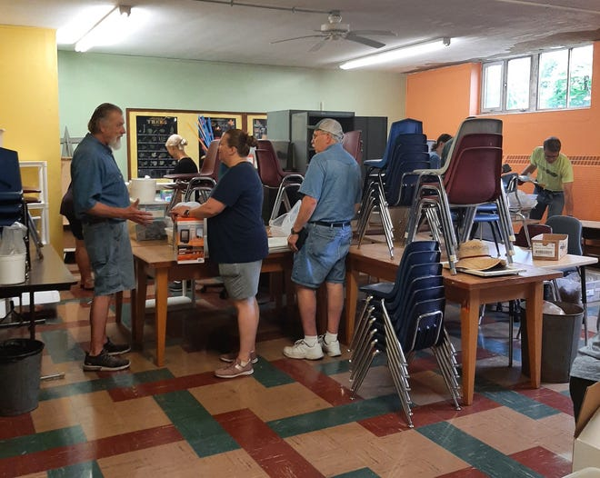Teachers and staff from Aquin Elementary School sort and prepare school supplies and equipment to be loaded up and moved to the high school campus on Wednesday, June 30, 2021, as the schools will combine under one roof for the upcoming school year.