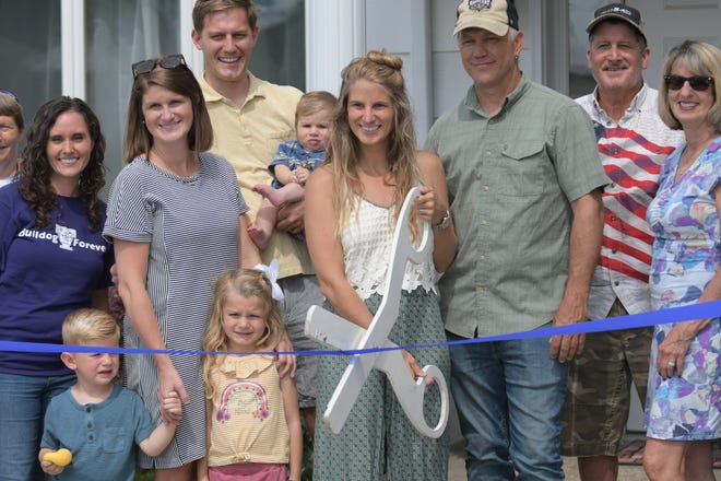 Amanda Montgomery participates in a ribbon-cutting ceremony Thursday, organized by the Kirksville Chamber of Commerce. Montgomery opened Mystic Meadows Yoga in April.