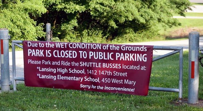 This banner is posted at the gate to Bernard Park. People attending the Lansing Independence Days celebration Saturday will need to park at a satellite location and use a free bus service to get to Bernard Park.