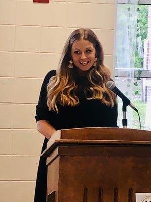 Samantha Coble accepts the Mineral County Teacher of the Year honor at a dinner held recently by the board of education. It was announced last week that Coble is among the ten finalists for the state Teacher of the Year honor.