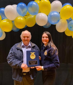 Steve Rexrode, father of Matthew Rexrode, presents Sarah Sions with the Outstanding Senior FFA Member award given in Matthew's memory. The other recipient was Bradley Sommers.