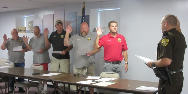 Taking office July 1, (l-r) Butch Hawse, Don McFarland, Bobby Lambert, Duke Lantz and Nick Imes were sworn in Tuesday as the Ridgeley Town Council by Department of Natural Resources sergeant Mike Lott.