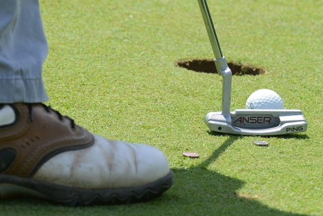 A player sets up a putt during the Greater Utica City Amateur Best-Ball competition in 2017 at Valley View Golf Course in Utica.