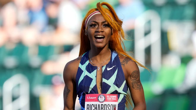 Sha'Carri Richardson celebrates after winning the first heat of the semifinals in women's 100-meter run at the U.S. Olympic Track and Field Trials in Eugene, Ore. Richardson cannot run in the Olympic 100-meter race after testing positive for a chemical found in marijuana.