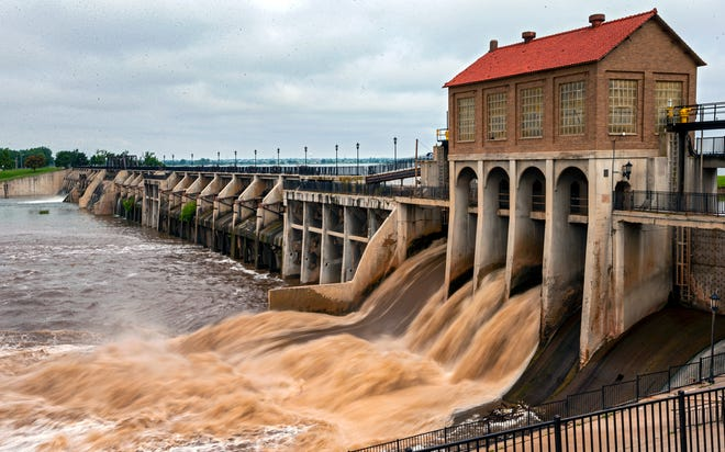 Water rushes through the dam at Lake Overholser in Oklahoma City on Friday. Recent heavy rains have raised water levels at many Oklahoma lakes and streams.