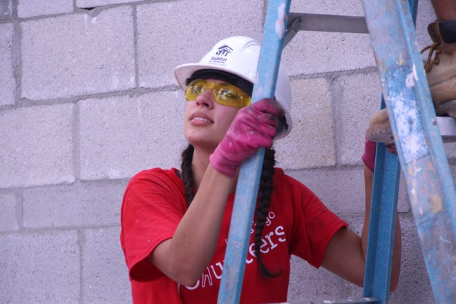 Wells Fargo Foundation's Carolina Tello works with Habitat for Humanity Palm Beach County to build affordable housing in Belle Glade and the surrounding areas.