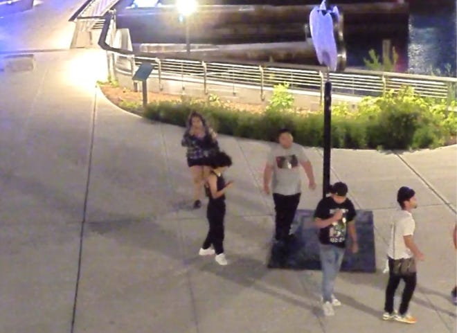 The Providence police are trying to identify the people in this photograph as the police investigate vandalism to the Providence River Pedestrian Bridge last month.