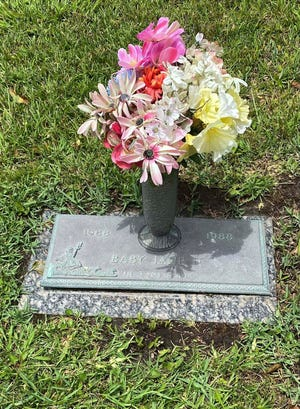This photo provided by the Jackson County Sheriff's Department shows the grave marker of Baby Jane II at Jackson County Memorial Park in Pascagoula, Mississippi. The weeks-old infant, found in the Pascagoula River in 1988, was never identified. She was buried by community members next to the grave site of another unidentified infant found in a Jackson County river in the 1980s called Baby Jane. Matt Hoggatt/Jackson County Sheriff's Department via AP