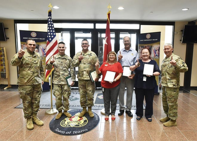 At a ceremony in Hoge Hall, Maj. Gen. James Bonner, Maneuver Support Center of Excellence and Fort Leonard Wood commanding general, and MSCoE and Fort Leonard Wood Command Sgt. Maj. Randolph Delapena presented two-star notes to Army Emergency Relief Officer Chuck Matthews and his team. (Photo by Brian Hill, Fort Leonard Wood Public Affairs Office)