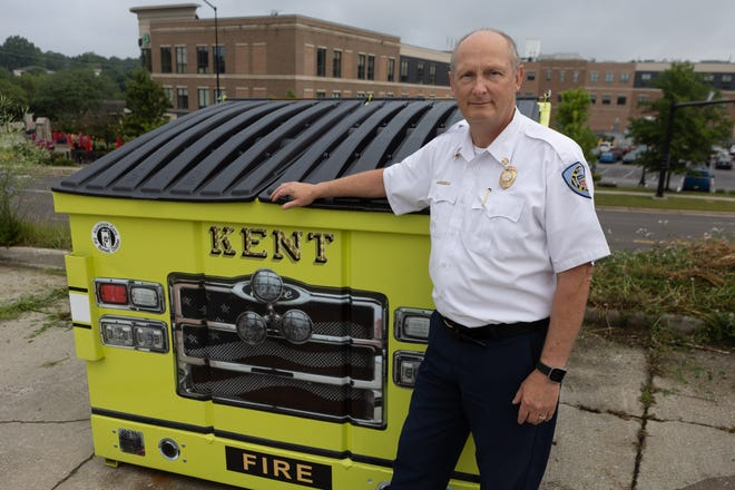 Kent Fire Chief John Tosko stands next to the new aluminum can recycling container located behind Kent Fire Department's Station 1 on South DePeyster Street. Proceeds from the recycling program go to Aluminum Cans for Burned Children. The organization raises money to help burn survivors and their families by funding educational and support programs, and paying for non-medical items or services that are not covered by insurance.