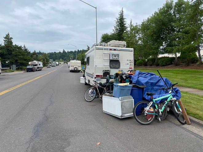 Some of the people moved their RVs and carts of belongings to Terry Street, one block over from Arrowsmith Street, where unhouse people were told to move by June 28 because of a paving project.