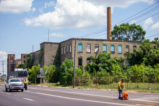 The city of South Bend has closed a lane of traffic closest to the former Wilson Shirt Factory on Sample Street because parts of the building have collapsed.