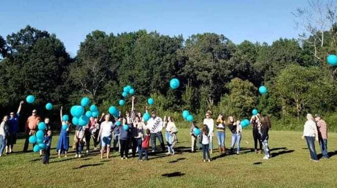 Family and friends gathered last year to celebrate the short life of Canaan Bradley with a balloon release.