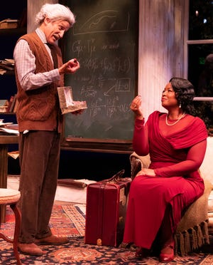 """David Edwards as Albert Einstein and Thursday Farrar as Marian Anderson in a scene from Deborah Brevoort's """"My Lord, What a Night"""" at Florida Studio Theatre."""