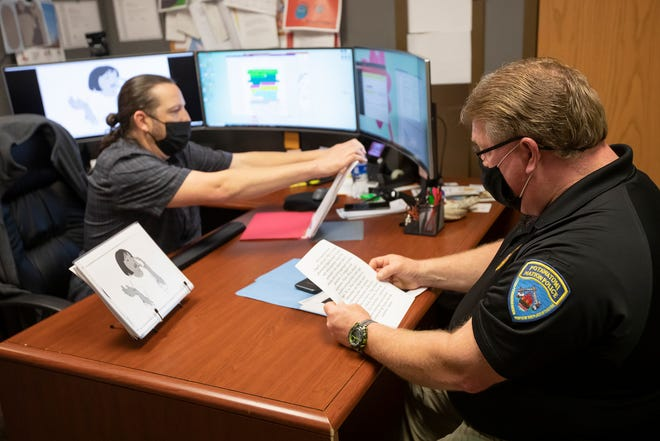 Partnering with CPN language aid Robert Collins (left) allows CPN Police Department Sgt. Chris Berry greater language-learning opportunities.