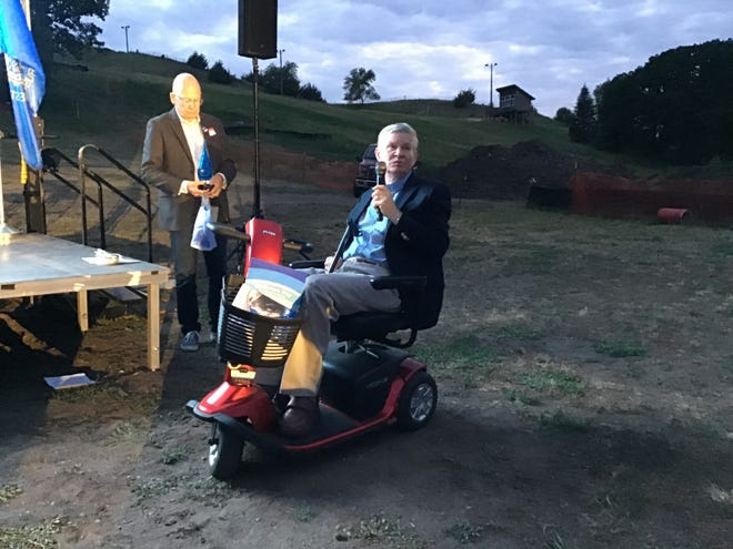 Former U.S. Sen. Tim Johnson, right, accepts the Goldie F. Wells Lifetime Achievement Award June 25, at Great Bear Ski Hill in Sioux Falls. South Dakota Democratic Party Chairman Randy Seiler presented the award to Johnson.