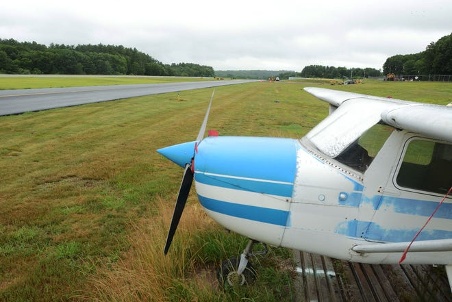 A newly paved runway, at left, at Danielson Airport Friday.