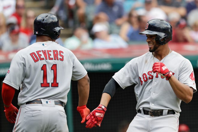 Boston Red Sox's Xander Bogaerts and Rafael Devers were named starters for the American League in this month's All-Star game in Colorado.