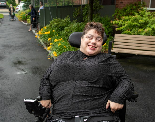 Christina Parissi navigates the city in a wheelchair and has petitioned the City Council for more attention to sidewalk repairs.