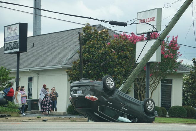 A Jeep rolled over after striking a utility pole in the 4700 block of Raeford Road on Friday, knocking down powerlines and shutting down the busy route. No injuries were reported, police said.